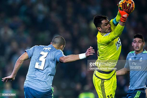 Goalkeeper Antonio Adan of Real Betis Balompie stops the ball behind Pepe of Real Madrid CF during the La Liga match between Real Betis Balompie and...