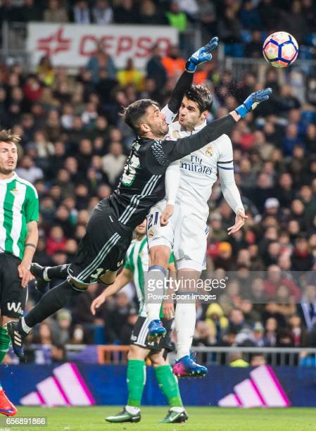 Goalkeeper Antonio Adan of Real Betis clashes with Alvaro Morata of Real Madrid while saving a shot during their La Liga match between Real Madrid...