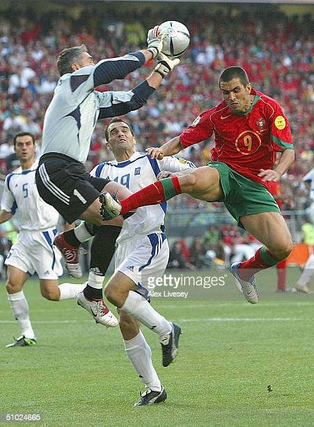 Goalkeeper Antonios Nikopolidis of Greece clashes with Pauleta of Portugal during the UEFA Euro 2004, Final match between Portugal and Greece at the...
