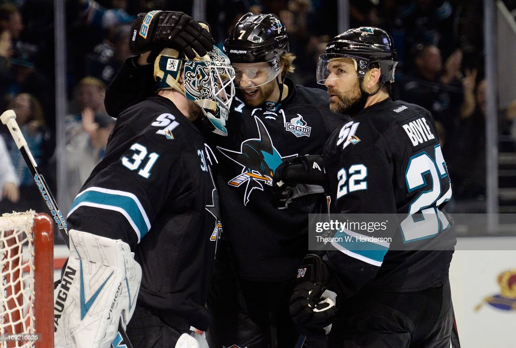Goalkeeper Antti Niemi #31, Brad Stuart #7 and Dan Boyle #22 of the San Jose Sharks celebrate defeating the Los Angeles Kings 2-1 in Game Four of the Western Conference Semifinals during the 2013 NHL Stanley Cup Playoffs at HP Pavilion on May 21, 2013 in San Jose, California.