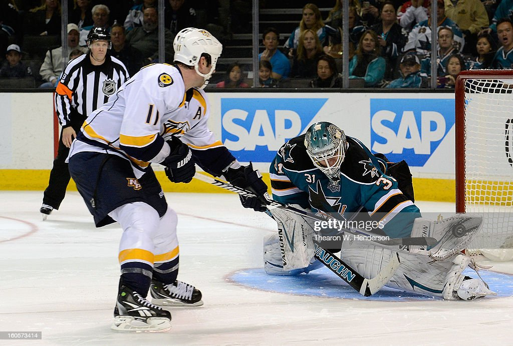 Goalkeeper Antti Niemi #31 of the San Jose Sharks blocks the shot from David Legwand #11 of the Nashville Predartor in an overtime shoot-out at HP Pavilion on February 2, 2013 in San Jose, California. The Predators won the game 2-1 in the shoot-out.