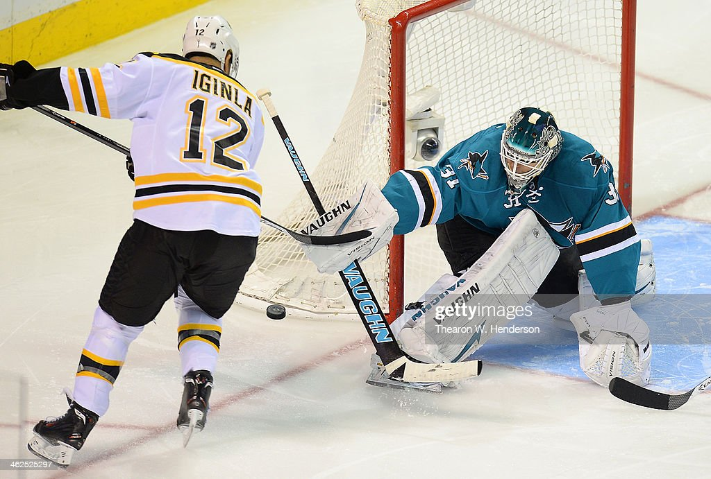 Goalkeeper Antti Niemi #31 of the San Jose Sharks blocks the shot of Jarome Iginla #12 of the Boston Bruins during the third period at SAP Center on January 11, 2014 in San Jose, California.