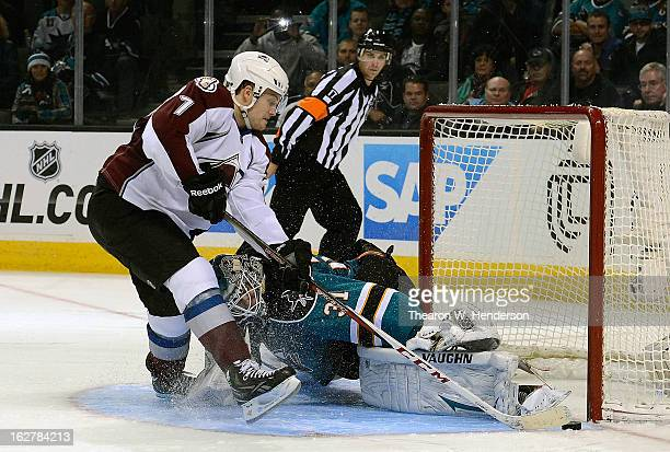 Goalkeeper Antti Niemi of the San Jose Sharks in a shootout blocks the shot of John Mitchell of the Colorado Avalanche the win the game 32 in...
