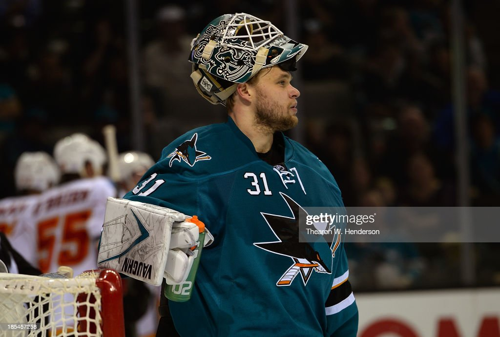 Goalkeeper Antti Niemi #31 of the San Jose Sharks looks on after giving up his second goal of the third period against the Calgary Flames at SAP Center on October 19, 2013 in San Jose, California.