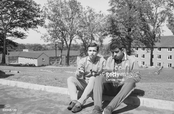 Goalkeeper Anzor Kavasashvili of the Russian World Cup squad and a team mate examine a new pair of boots 23rd July 1966