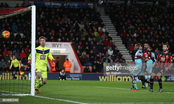 Goalkeeper Artur Boruc of Bournemouth watches the ball as Enner Valencia of West Ham United scores their third goal during the Barclays Premier...