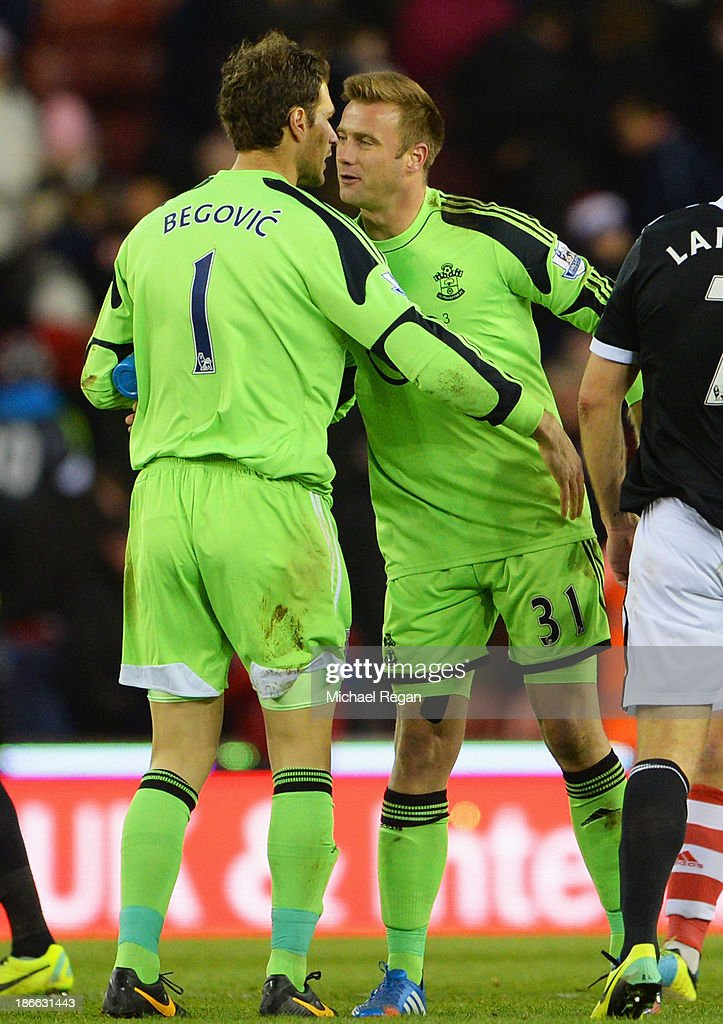 Goalkeeper Artur Boruc of Southampton congratulates Asmir Begovic of Stoke City after his goal during the Barclays Premier League match between Stoke City and Southampton at Britannia Stadium on November 2, 2013 in Stoke on Trent, England.