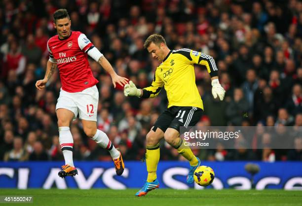 Goalkeeper Artur Boruc of Southampton loses the ball to Olivier Giroud of Arsenal leading to the opening goal during the Barclays Premier League...