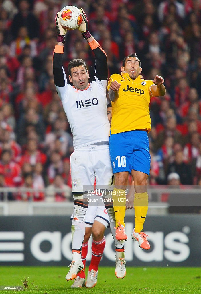 Goalkeeper Artur of Benfica is challenged for the ball by Carlos Tevez of Juventus during the UEFA Europa League Semi Final first leg match between SL Benfica andJuventus at Estadio da Luz on April 24, 2014 in Lisbon, Portugal.