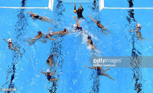 Goalkeeper Ashleigh Johnson makes a save during the Women's Water Polo quarter final match between Hungary and USA at Olympic Aquatics Stadium on...