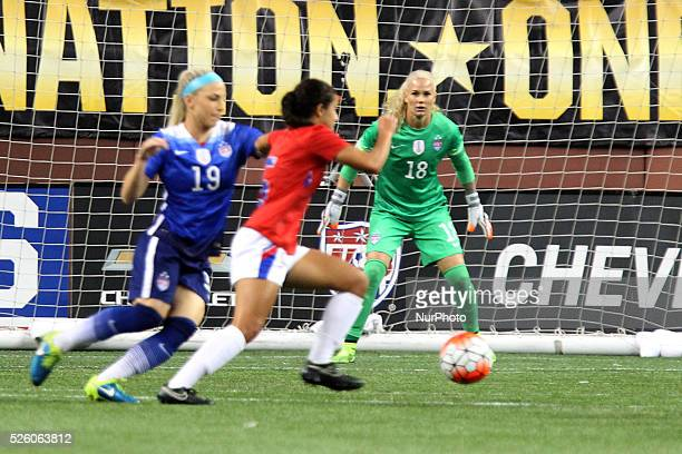 US goalkeeper Ashlyn Harris defends against a goal attampt by Haiti forward Sabine Chandler under the pressures of US defender Julie Johnston in the...