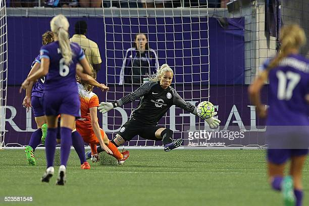 Goalkeeper Ashlyn Harris of Orlando Pride makes a save during a NWSL soccer match against the Houston Dash at the Orlando Citrus Bowl on April 23...