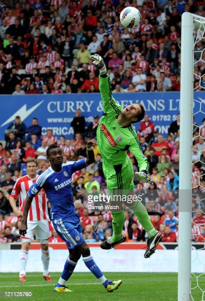 Goalkeeper Asmir Begovic of Stoke tips the ball over his crossbar during the Barclays Premier League match between Stoke City and Chelsea at the...