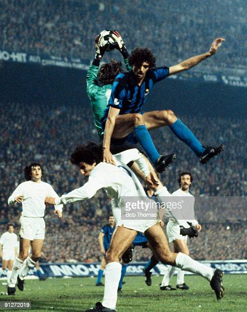Goalkeeper Augustin Rodriquez of Real Madrid catches the ball as Alessandro Altobelli of InterMilan leaps over Andres Sabido of Real Madrid during...