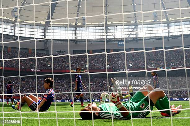Goalkeeper Ayumi Kaihori of Japan is unable to save a shot by Carli Lloyd of the United States as Lloyd scores her second goal in the first half in...