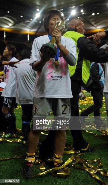 Goalkeeper Ayumi Kaihori of Japan kisses the trophy after winning the FIFA Women's World Cup Final match between Japan and USA at the FIFA Women's...