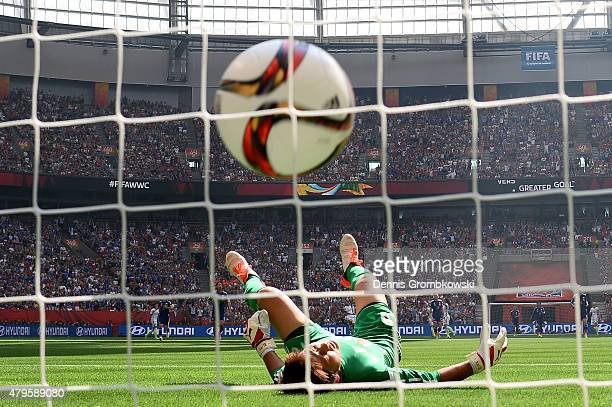 Goalkeeper Ayumi Kaihori of Japan reacts after she is unable to save a goal by Carli Lloyd of the United States as Lloyd scores her third goal in the...