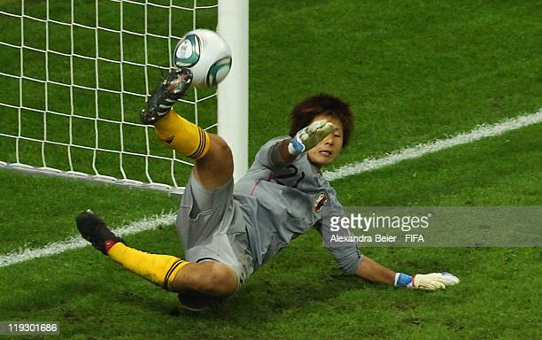 Goalkeeper Ayumi Kaihori of Japan saves a ball during the penalty shoot-out of the FIFA Women's World Cup Final match between Japan and USA at the...
