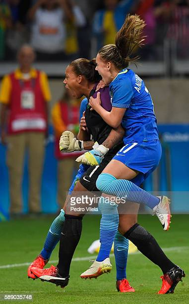 Goalkeeper Barbara of Brazil celebrates with teammate Andressa after Barbara saved a goal during Penalties Shootout to win 00 against Australia...