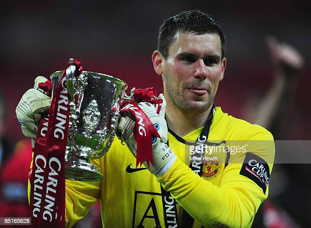 Goalkeeper Ben Foster of Manchester United celebrates with the trophy after victory during the Carling Cup Final match between Manchester United and...