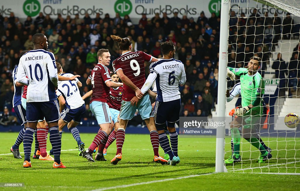 Goalkeeper Ben Foster of West Bromwich Albion looks on as James Tomkins of West Ham United (obscured centre) scores their second goal during the Barclays Premier League match between West Bromwich Albion and West Ham United at The Hawthorns on December 2, 2014 in West Bromwich, England.