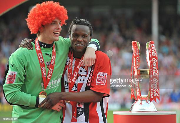 Goalkeeper Ben Hamer and Marcus Bean of Brentford wait to be presented with the League Two trophy during the CocaCola League Two match between...