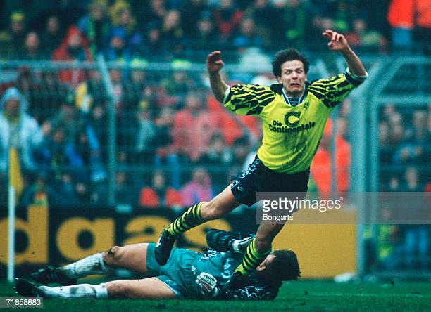 Goalkeeper Bernd Dreher of Uerdingen and Andreas Moeller of Dortmund battle for the ball during the bundesliga match between Borussia Dortmund and...