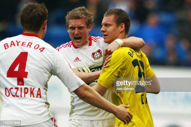 goalkeeper Bernd Leno Andre Schuerrle and Bastian Oczipka of Leverkusen celebrate after Leno saved a penalty of Sejad Salihovic of Hoffenheim during...