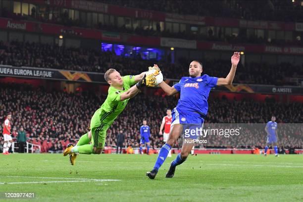 Goalkeeper Bernd Leno of Arsenal and Youssef ElArabi during Europa League Round of 32 2nd Leg between Arsenal and Olympiakos at Emirates stadium...