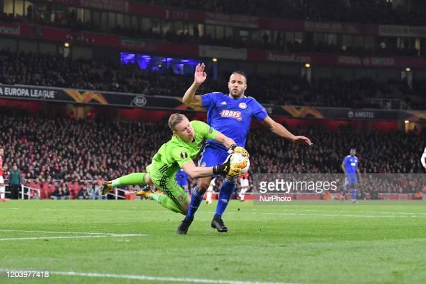 Goalkeeper Bernd Leno of Arsenal FC and Youssef ElArabi during Europa League Round of 32 2nd Leg between Arsenal and Olympiakos at Emirates stadium...