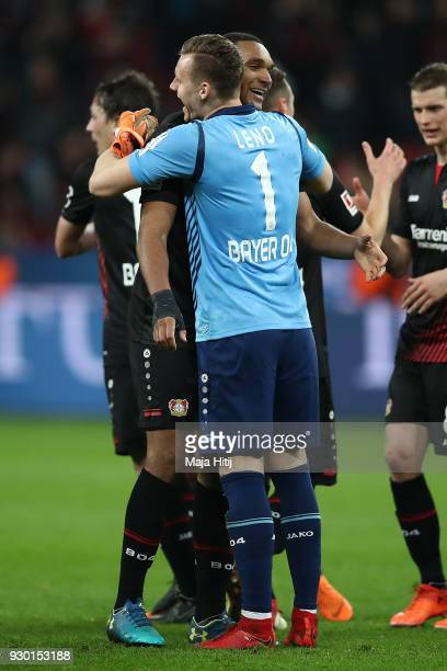 Goalkeeper Bernd Leno of Bayer Leverkusen celebrates with Jonathan Tah of Bayer Leverkusen after the Bundesliga match between Bayer 04 Leverkusen and...