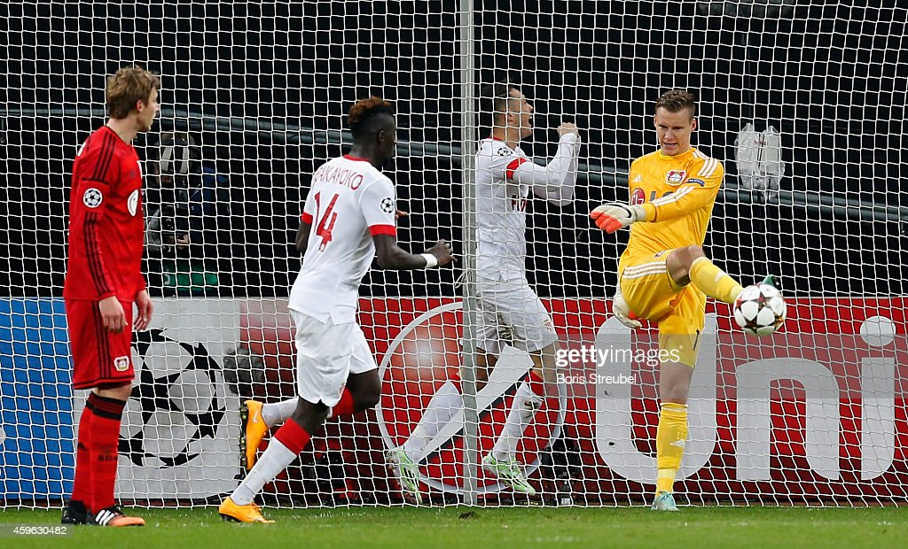 Goalkeeper Bernd Leno of Bayer Leverkusen kicks the ball out of his goal after Lucas Ocampos of Monaco (2.L) celebrate his team's first goal during the UEFA Champions League group C match between Bayer 04 Leverkusen and AS Monaco FC at BayArena on November 26, 2014 in Leverkusen, Germany.