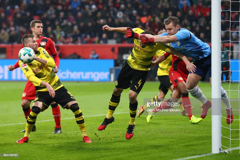 Goalkeeper Bernd Leno of Bayer Leverkusen saves against Neven Subotic of Dortmund (4) during the Bundesliga match between Bayer 04 Leverkusen and Borussia Dortmund at BayArena on December 2, 2017 in Leverkusen, Germany.
