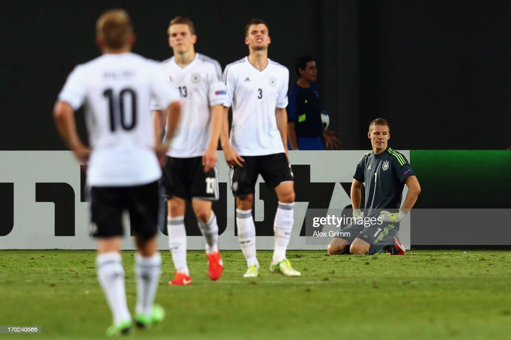 Goalkeeper Bernd Leno (R) of Germany and team mates react after Alvaro Morata (not in th epicture) of Spain scored his team's winning goal during the UEFA European U21 Champiosnship Group B match between Germany and Spain at Netanya Stadium on June 9, 2013 in Netanya, Israel.