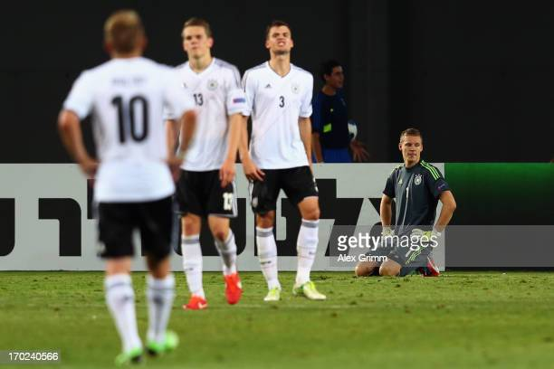 Goalkeeper Bernd Leno of Germany and team mates react after Alvaro Morata of Spain scored his team's winning goal during the UEFA European U21...