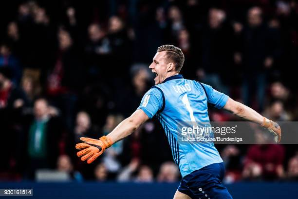 Goalkeeper Bernd Leno of Leverkusen celebrates his teams second goal during the Bundesliga match between Bayer 04 Leverkusen and Borussia...