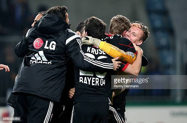 Goalkeeper Bernd Leno of Leverkusen celebrates with his team mates after the penalty shootout during the DFB Cup second round match between 1 FC...