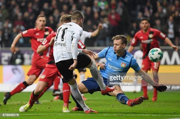 MAIN GERMANY NOVEMBER Goalkeeper Bernd Leno of Leverkusen saves a ball of Mijat Gacinovic of Frankfurt during the Bundesliga match between Eintracht...
