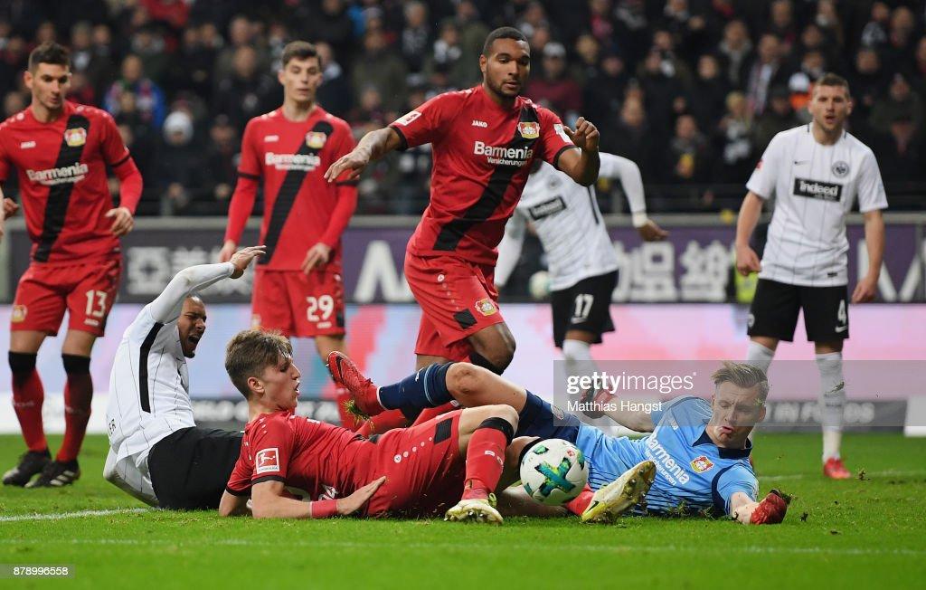 Goalkeeper Bernd Leno of Leverkusen saves a ball of Sebastien Haller of Frankfurt during the Bundesliga match between Eintracht Frankfurt and Bayer 04 Leverkusen at Commerzbank-Arena on November 25, 2017 in Frankfurt am Main, Germany.
