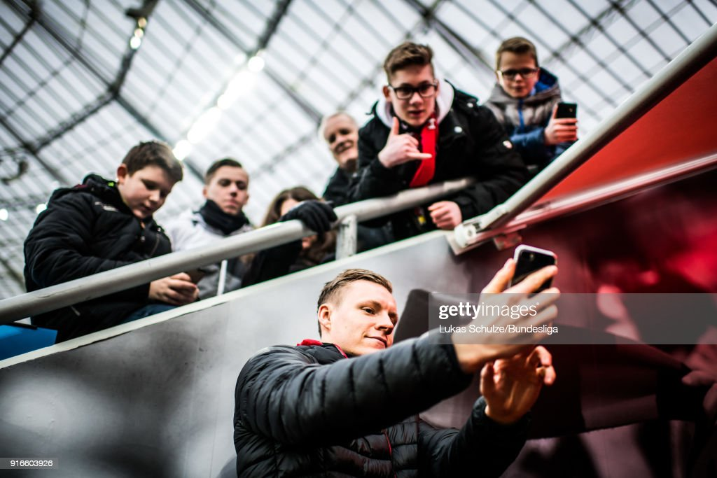 Goalkeeper Bernd Leno of Leverkusen takes a selfie with young fans prior to the Bundesliga match between Bayer 04 Leverkusen and Hertha BSC at BayArena on February 10, 2018 in Leverkusen, Germany.