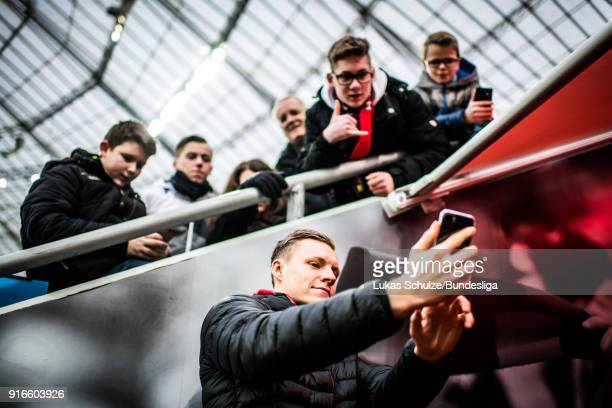 Goalkeeper Bernd Leno of Leverkusen takes a selfie with young fans prior to the Bundesliga match between Bayer 04 Leverkusen and Hertha BSC at...