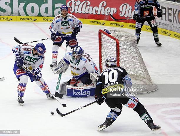 Goalkeeper Bernhard Starkbaum stops a shot by Reid Cashman of Linz during the Erste-Bank EHL match between EC Rekord Fenster VSV and EHC LIWEST Linz...