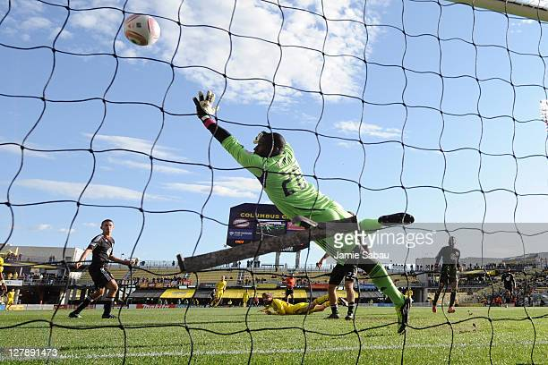 Goalkeeper Bill Hamid of DC United can't stop this header shot from Eddie Gaven of the Columbus Crew for the Crew's second goal in a 21 win on...