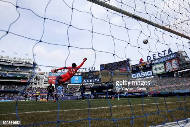 Goalkeeper Bill Hamid of DC United is beaten by a shot from Jack Harrison of New York City FC which hit the bar and resulted in Rodney Wallace of New...