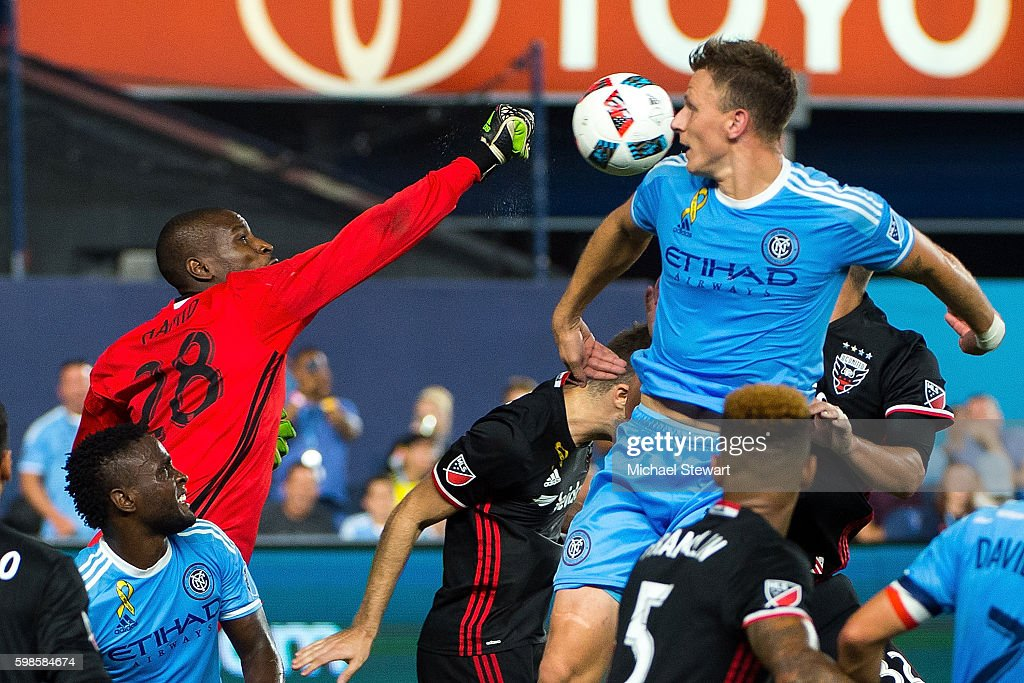 Goalkeeper Bill Hamid #28 of D.C. United punches the ball away during the match vs New York City FC at Yankee Stadium on September 1, 2016 in New York City. New York City FC defeats D.C. United 3-2.
