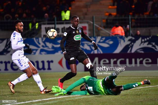 Goalkeeper Bingourou Kamara of Strasbourg gets to the ball before Lassana Doucoure of Chambly during the French Cup match between Chambly and...