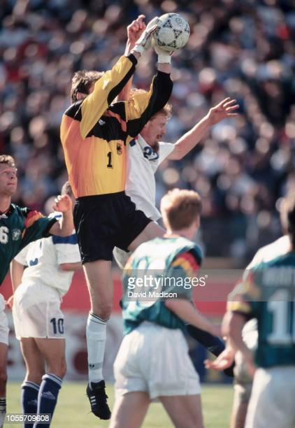 Goalkeeper Bodo Illgner of Germany reaches for a ball during an international friendly match against the USA on December 18 19983 at Stanford Stadium...