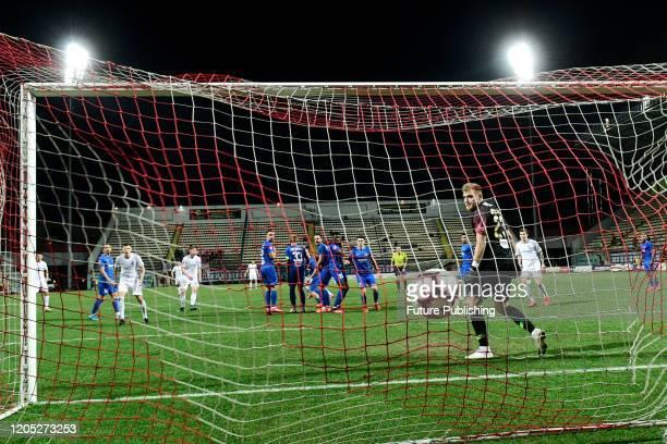 ZAPORIZHZHIA UKRAINE Goalkeeper Bohdan Sarnavskyi of PFC Lviv misses a goal from FC Zorya Luhansk during the Ukrainian Premier League Matchday 21...
