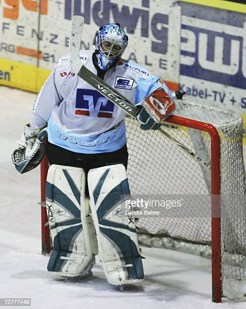 Goalkeeper Boris Rousson of Hamburg reacts after failing to save the fourth goal during the DEL Bundesliga game between Augsburger Panther and...