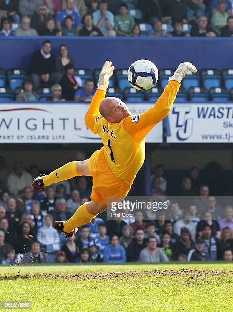 Goalkeeper Brad Friedel of Aston Villa makes a diving save during the Barclays Premier League match between Portsmouth and Aston Villa at Fratton...